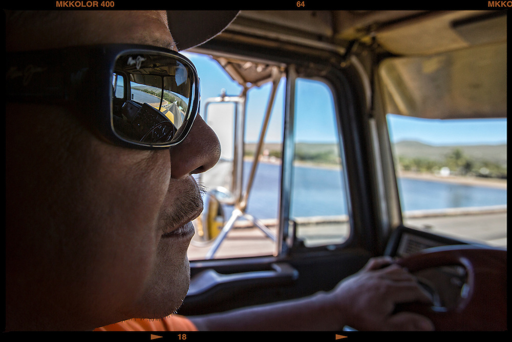 Makoa Trucking & Services  President and Co Owner Gordon Nae'ole drives another load of the wharf in Kaunakakai.