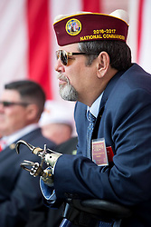 November 11, 2016 - Arlington, United States of America - David Riley, National Commander of the Disabled American Veterans, listens to President Obama speak during a Veterans Day ceremony at the Memorial Amphitheater at Arlington National Cemetery November 11, 2016 in Arlington, Virginia. (Credit Image: © Pete Souza/Planet Pix via ZUMA Wire)