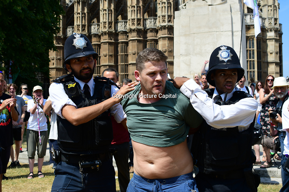 Terry White is a scams oil seller arrested during Protest for legalization of cannabis outside Parliament on 6th July 2018.