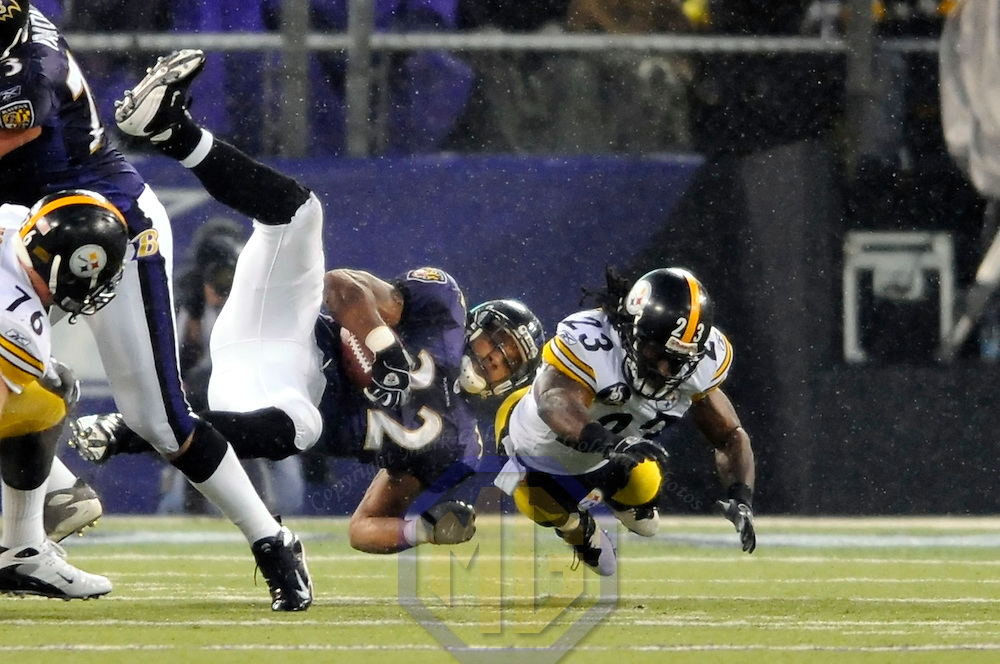 30 December 2007:  Baltimore Ravens running back Musa Smith (32) breaks free for a 14-yard gain in the rain before a hard tackle by Pittsburgh Steelers safety Tyrone Carter (23) in the first half on December 30, 2007 at M&T Bank Stadium in Baltimore, Maryland. The Ravens defeated the Steelers 27-21..