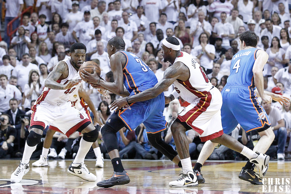 21 June 2012: `Miami Heat power forward Udonis Haslem (40) and Miami Heat small forward LeBron James (6) defend on Oklahoma City Thunder small forward Kevin Durant (35) during the Miami Heat 121-106 victory over the Oklahoma City Thunder, in Game 5 of the 2012 NBA Finals, at the AmericanAirlinesArena, Miami, Florida, USA. The Miami Heat wins the series 4-1.
