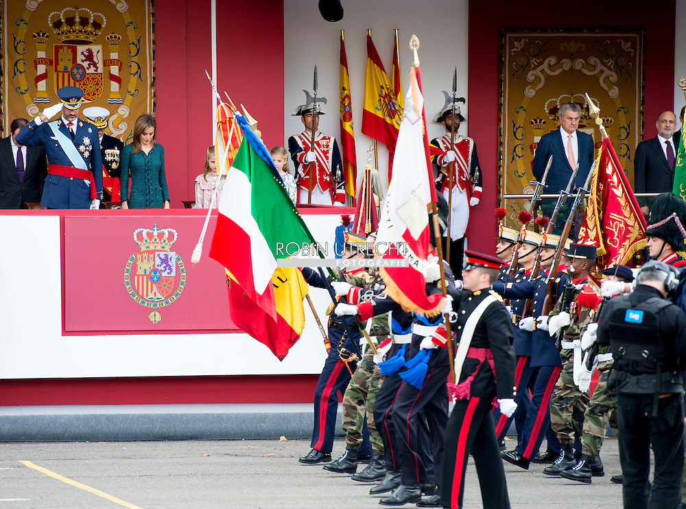 12-10-2014 MADRID - Spanish King Felipe VI, Queen Letizia and their daughters, Princesses Leonor and Sofia watch an military flyover during an army parade marking Spain's National Day in Madrid, Spain, 12 October 2014. COPYRIGHT ROBIN UTRECHT
