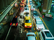 27 MAY 2017 - BANGKOK, THAILAND: Traffic on Rama I Street, which was flooded by monsoonal rains. The rainy season in Bangkok usually starts in mid-June but started almost a month early this year. There have been daily thunderstorms and localized flooding throughout central Thailand since the middle of May.     PHOTO BY JACK KURTZ