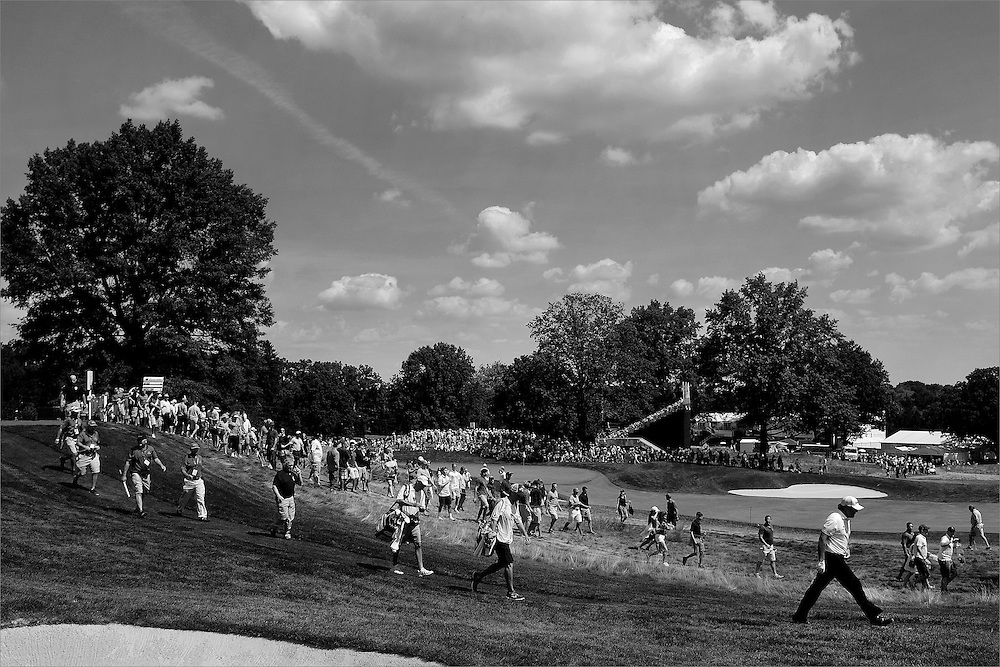 Phil Mickelson (right) walks towards the seventh fairway during the third round of The Barclays Championship held at Plainfield Country Club in Edison, New Jersey on August 29.