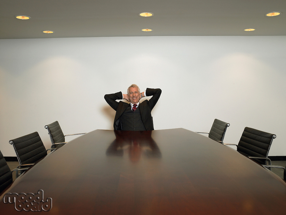 Businessman relaxing in conference room