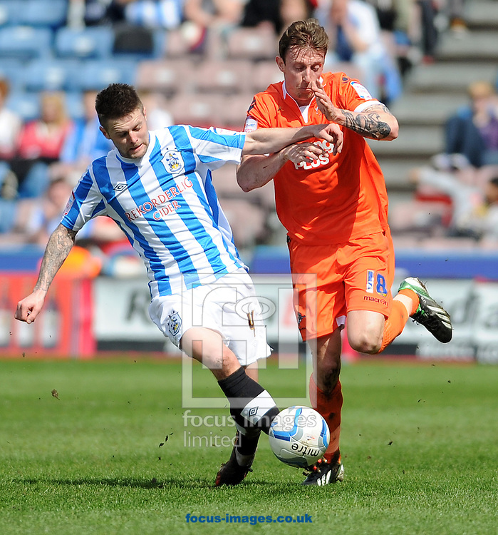 Picture by Graham Crowther/Focus Images Ltd +44 7763 140036.20/04/2013.Oliver Norwood of Huddersfield Town battles with Martyn Woolford of Millwall during the npower Championship match at the John Smiths Stadium, Huddersfield.