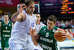 Nenad Krstic of Serbia vs Jaka Lakovic (5) of Slovenia during the EuroBasket 2009 Semi-final match between Slovenia and Serbia, on September 19, 2009, in Arena Spodek, Katowice, Poland. Serbia won after overtime 96:92.  (Photo by Vid Ponikvar / Sportida)