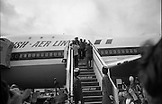 Muhammad Ali In Dublin..1972..11.07.1972..07.11.1972..11th July 1972..Prior to his fight against Al 'Blue' Lewis at Croke Park ,Dublin, former World Heavyweight Champion,Muhammad Ali arrives at Dublin Airport..The fight was part of his build up for for a championship fight against the current World Champion, 'Smokin'  Joe Frazier. Ali had been stripped of the title partly due to his refusal to join the American military during The Vietnam War,which he had opposed...Picture Of Muhammad Ali saluting waiting fans and media as he disembarks from an Aer Lingus Jumbo Jet.