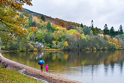 View of waterfront at village of Kenmore during autumn on Loch Tay in Perthshire , Scotland, United Kingdom.