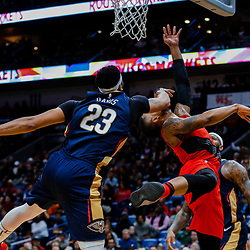 Jan 12, 2018; New Orleans, LA, USA; Portland Trail Blazers guard Damian Lillard (0) is hit in the face by New Orleans Pelicans forward Anthony Davis (23) while shooting during the second half at the Smoothie King Center. The Pelicans defeated the Trail Blazers 119-113. Mandatory Credit: Derick E. Hingle-USA TODAY Sports