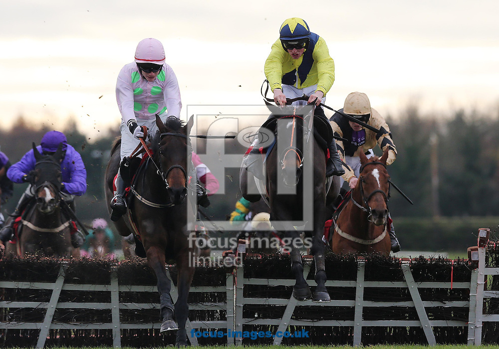 Picture by Lorraine O'Sullivan/Focus Images Ltd +353 872341234<br /> 01/12/2013<br /> Danny Mullins pictured on The Tullow Tank (on right) wins from Paul Townend on Renneti (on left) during The Bar One Racing Royal Bond Novice Hurdle at Fairyhouse Races at Fairyhouse Racecourse, Ratoath.