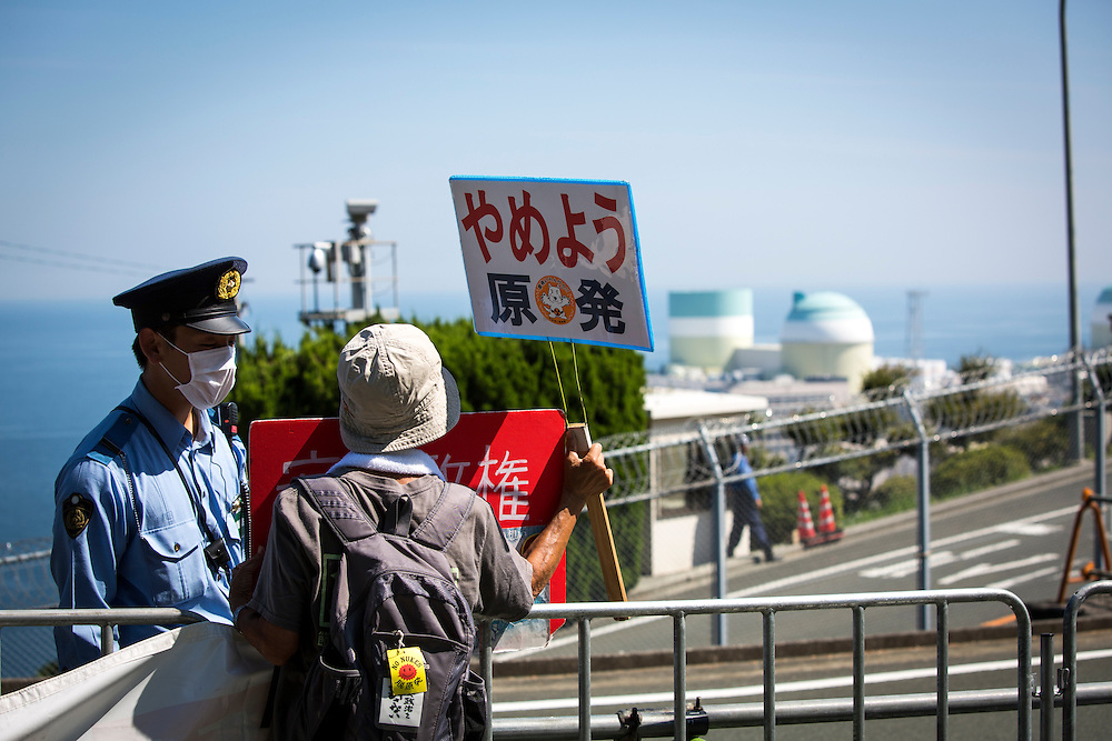 EHIME, JAPAN - AUGUST 11 : Anti-nuclear protester with placards stand in front of Ikata Nuclear Power Plant to protest against the restarting of a nuclear reactor on August 11, 2016 in Ikata, Ehime prefecture, northwestern Shikoku, Japan. The No. 3 reactor of the nuclear plant is expected to resume operations this week after The Nuclear Regulation Authority (NRA's) has completed it's final inspections of the plant's operational safety measures. The plant has not generated nuclear power since Japan's 2011 nationwide shutdown of all nuclear plants in the aftermath of the Fukushima Daiichi nuclear disaster. Ikata Nuclear Power Plant will be the third nuclear power plant in Japan to become operational. (Photo by Richard Atrero de Guzman/NURPhoto)