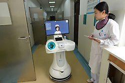 April 17, 2018 - Henan, Henan, China - Henan,CHINA-17th April 2018: A robot nurse can be seen at a hospital in central China's Henan Province. The robot can send medicine to patients and check the health situation. (Credit Image: © SIPA Asia via ZUMA Wire)