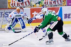 Petr Sachl (HDD Tilia Olimpija, #12) and in background Gert Prohaska (EC Rekord-Fenster VSV, #35) during ice-hockey match between HDD Tilia Olimpija and EC Rekord-Fenster VSV in 46th Round of EBEL league, on Februar 6, 2011 at Hala Tivoli, Ljubljana, Slovenia. (Photo By Matic Klansek Velej / Sportida.com)