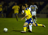 Fotball<br /> England 2005/2006<br /> Foto: SBI/Digitalsport<br /> NORWAY ONLY<br /> <br /> Colchester United v Cardiff City. Carling Cup.<br /> 24/08/2005.<br /> Jason Koumas of Cardiff goes past Sam Stockley of Colchester