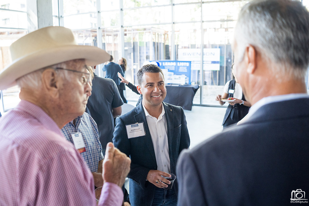Nicholas Adams of NINICO Communications networks during SVBJ's BizMix presented by SWENSON at The Grad in Downtown San Jose, California, on July 31, 2019. (Stan Olszewski for Silicon Valley Business Journal)
