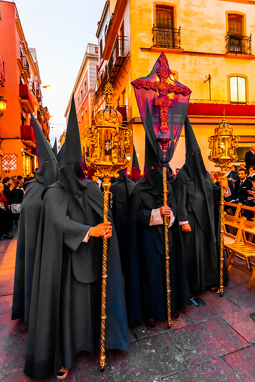 Hooded Penitents (Nazarenos) in the procession of the Brotherhood (Hermandad) La Quinta Angustia, Holy Week (Semana Santa), Seville, Andalusia, Spain.