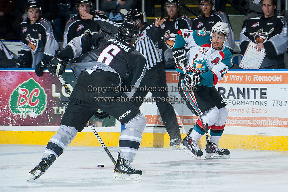 KELOWNA, CANADA - JANUARY 4: Tyrell Goulbourne #12 of the Kelowna Rockets passes the puck against the Vancouver Giants on January 4, 2014 at Prospera Place in Kelowna, British Columbia, Canada.   (Photo by Marissa Baecker/Shoot the Breeze)  ***  Local Caption  ***