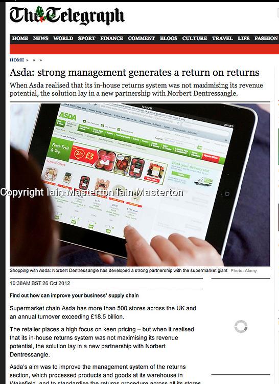 The Telegraph; woman browsing Asda website on iPad tablet computer
