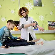 Kirill receives physiotherapy at the National Cancer Institute in Kiev. Zaporuka pays the psychologists and physiotherapists working with children affected by cancer and treated at the hospital. People claim that hospitals appear to be corrupted with patients forced to pay bribes.