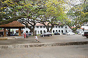 Child running across historic Court Square in the town of Galle, Sri Lanka, Asia