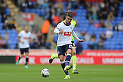 Bolton Wanderers striker Gary Madine plays a short pass during the Sky Bet Championship match between Bolton Wanderers and Brighton and Hove Albion at the Macron Stadium, Bolton, England on 26 September 2015.