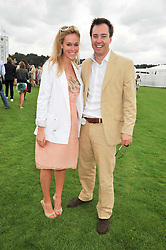 JAMIE MURRAY-WELLS and EVY LANGTON at the 25th annual Cartier International Polo held at Guards Polo Club, Great Windsor Park, Berkshire on 26th July 2009.