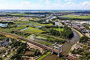 Nederland, Zuid-Holland, Gouda, 15-07-2012; spoorbrug over de Gouwe (viersporige hefbrug). Hoge Gouwebrug. Bedrijventerrein rond het riviertje, links de Zuidplaspolder, rechts Goudse Poort..Railway and lift bridge over the river Gouwe, business park in the back. .luchtfoto (toeslag), aerial photo (additional fee required).foto/photo Siebe Swart