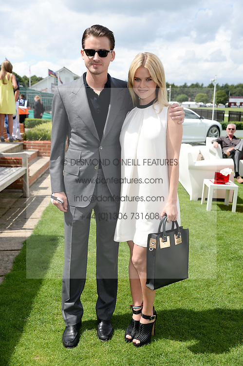 ALICE EVE and her brother JACK EVE at the Audi International Polo at Guards Polo Windsor Great Park, Egham, Surrey on 28th July 2013.