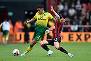Ben Godfrey (4) of Norwich City is tackled by Adam Smith (15) of AFC Bournemouth during the Premier League match between Bournemouth and Norwich City at the Vitality Stadium, Bournemouth, England on 19 October 2019.