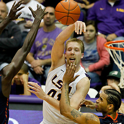 January 2, 2012; Baton Rouge, LA; LSU Tigers center Justin Hamilton (41)passes between Virginia Cavaliers center Assane Sene (5) and forward Mike Scott (23) during the second half of a game at the Pete Maravich Assembly Center. Virginia defeated LSU 57-52.  Mandatory Credit: Derick E. Hingle-US PRESSWIRE