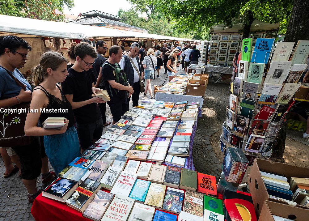 Bookstall at weekend flea market in Boxhagener Platz in Friedrichshain , Berlin, Germany