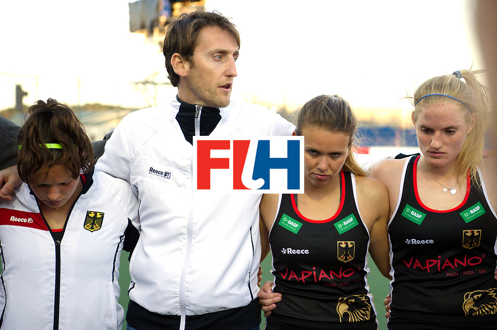 AUCKLAND - Sentinel Hockey World League final women<br /> Match id: 10303<br /> 13 GER v KOR (QF) 3-3<br /> Korea in to semi after shoot out.<br /> Foto: Xavier RECKINGER Head Coach aftwer the lost match, with Charlotte Stapenhorst (l) and Anne Schroeder next tonhim.<br /> WORLDSPORTPICS COPYRIGHT FRANK UIJLENBROEK