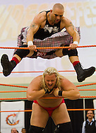 """Mosh (Charles Warrington), half of the duo known as the Headbangers, jumps on Bam Bam (Brian Brock), who is with the tag team Dirty Blondes, during Championship Wrestling Entertainment's """"Wrestlefest"""" event at the Port St. Lucie Civic Center on Friday, April 10, 2015. (XAVIER MASCAREÑAS/TREASURE COAST NEWSPAPERS)"""