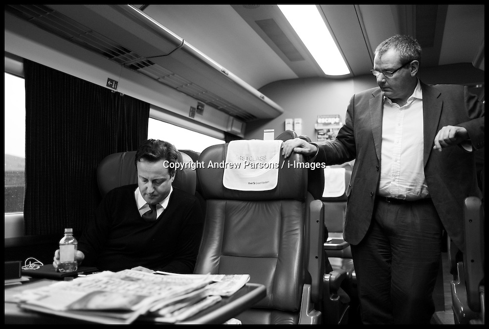 The Prime Minister David cameron working on the train to Wales during his Local Election Campaign, Friday April 1, 2011. Photo By Andrew Parsons / i-Images.