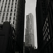 Frank Gehry's New York By Gehry 8 Spruce Street with a tiny water tower at the base.