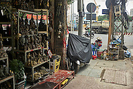Antiques shop selling religious figurines along Le Cong Kieu Street (antique street) in Ho Chi Minh City, Vietnam, Southeast Asia