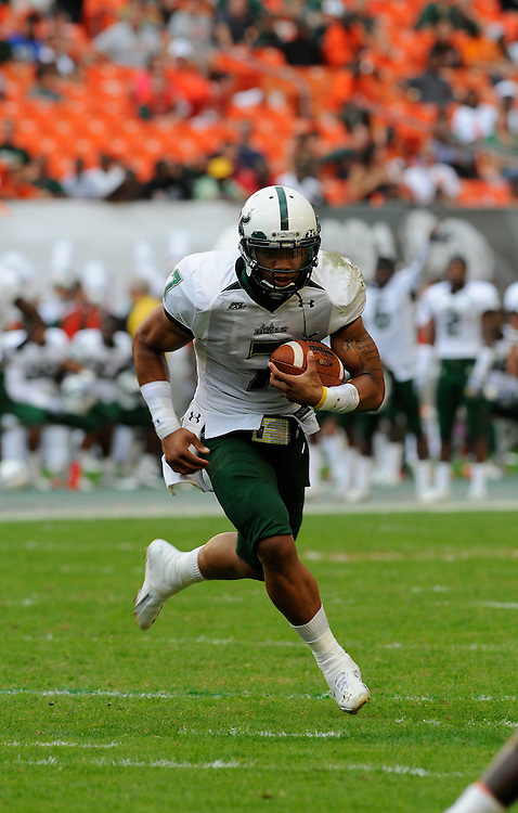 MIAMI GARDENS, FL - NOVEMBER 27: B.J. Daniels of the South Florida Bulls scrambles during the game against the Miami Hurricanes at Sun Life Stadium on November 27, 2010 in Miami Gardens, Florida.