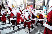 Santas deliver holiday PEEPS and spread cheer in New York's Times Square, Wednesday, Dec. 4, 2013. (Photo by Diane Bondareff/Invision for PEEPS/AP Images)