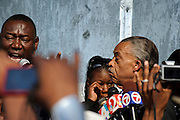 Matt Roth/Novus Select.Thursday, March 22, 2012..Members of the press and rally-goers photograph Benjamin Crump, Trayvon Martin's parents' attorney, who, along with Rev. Al Sharpton, announce that the Sanford Chief of Police Bill Lee has temporarily stepped down before the official start of a rally at Fort Mellon Park in Sanford, Florida Thursday, March 22, 2012 addressing 17-year-old Trayvon Martin's killing. Trayvon Martin's mother Sybrina Fulton, stands in the background...Rev. Al Sharpton spoke at the rally for the slain black teen who was unarmed and shot after an altercation by neighborhood watch volunteer George Zimmerman, who pursued Trayvon on foot after being told not to by 911 dispatchers. Zimmerman has yet to be arrested because of Florida's Stand Your Ground Law.