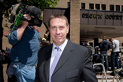 © London News Pictures. 05/06/2013. London, UK. Former News of the World royal editor CLIVE GOODMAN leaving Southwark Crown Court in London where he faced charges relating to phone hacking scandal at News International and payments to officials. Photo credit: Ben Cawthra/LNP