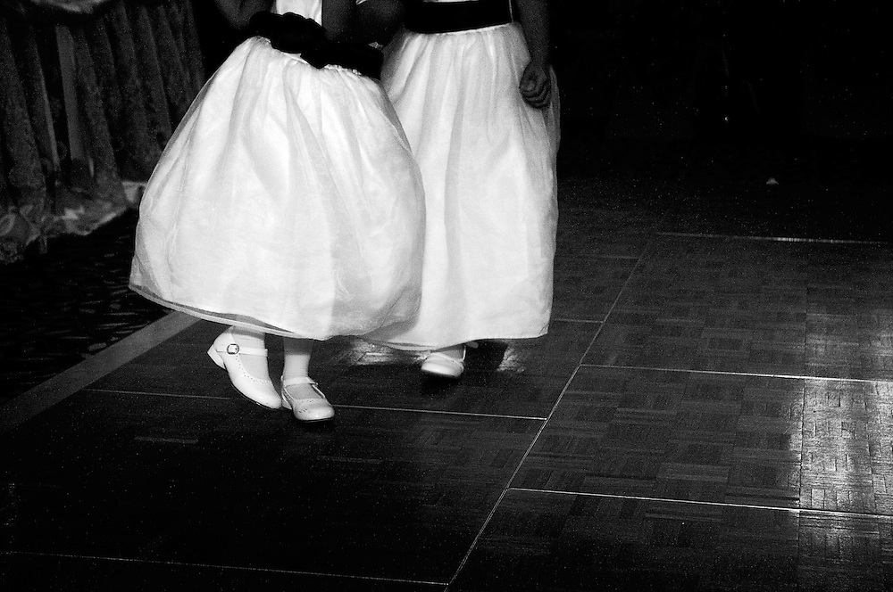 Girls dance in their Mary Janes during a wedding reception.