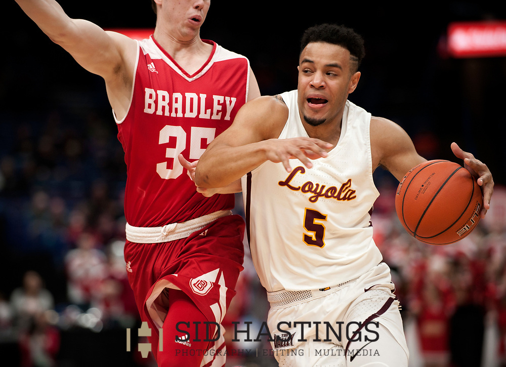 Loyola University Chicago basketball player Marques Townes (5) drives against Bradley University's Jayden Hodgson (35) during the semifinals of the Missouri Valley Conference men's basketball tournament at Scottrade Center in St. Louis Saturday, March 3, 2018. LUC won, 62-54. Photo © copyright 2018 Sid Hastings.