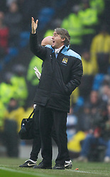 MANCHESTER, ENGLAND - Sunday, January 8, 2012: Manchester City's manager Roberto Mancini against Manchester United during the FA Cup 3rd Round match at the City of Manchester Stadium. (Pic by Vegard Grott/Propaganda)