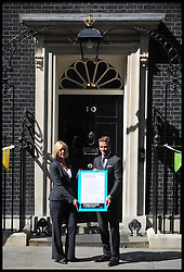 Footballer David Beckham (L) arrives in Downing Street to meet with British Prime Minister David Cameron with Anita Tiessen, the Deputy Executive Director of UNICEF UK,, Thursday July 26, 2012. Photo by Andrew Parsons/i-Images.All Rights Reserved ©Andrew Parsons.See Instructions