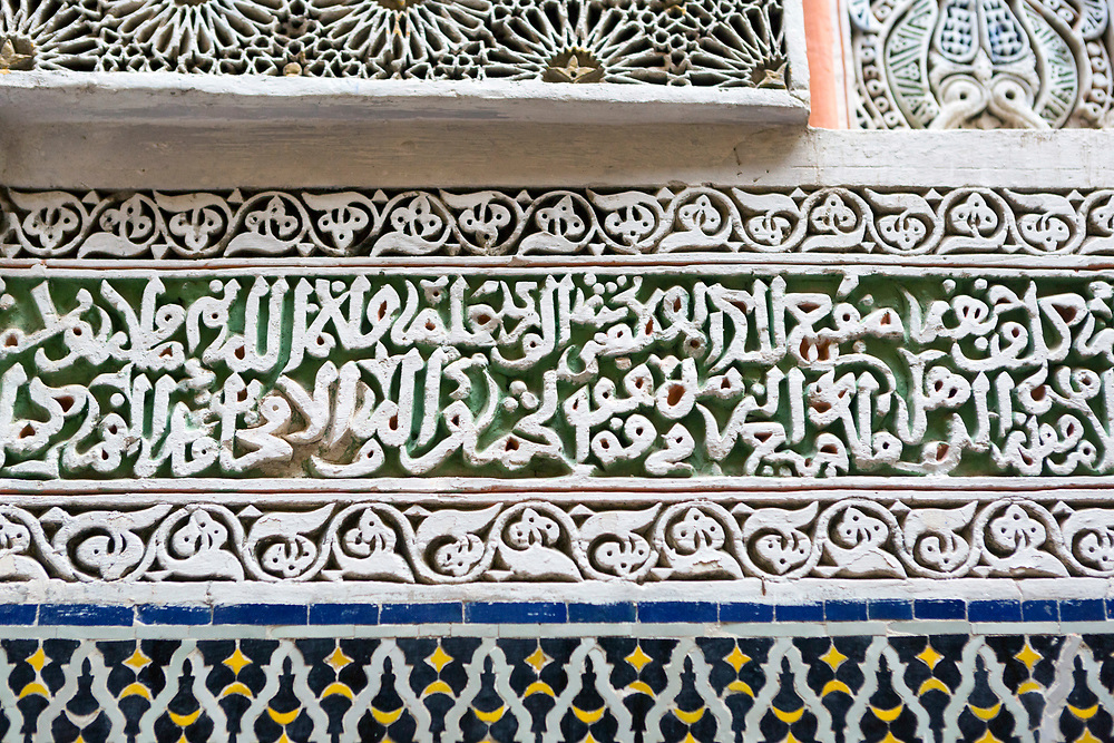 FEZ, MOROCCO, 1ST FEBRUARY 2018 - Intricate zellige mosaic work and stone carvings on the building exterior of the Zawiya Moulay Idriss II, old Fez Medina, Middle Atlas Mountains, Morocco.