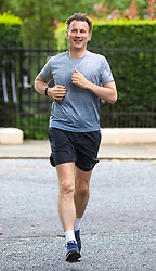 © Licensed to London News Pictures. 01/07/2019. London, UK. Foreign Secretary Jeremy Hunt, who is running against Boris Johnson to become the next Leader of the Conservative Party and prime minister, returns to his London home after a run. Photo credit: Rob Pinney/LNP