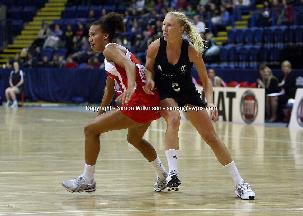 PICTURE BY VAUGHN RIDLEY/SWPIX.COM...Netball - International Netball Series - England v New Zealand - Capital FM Arena, Nottingham, England - 17/01/11...New Zealand's Laura Langman and England's Serena Guthrie.