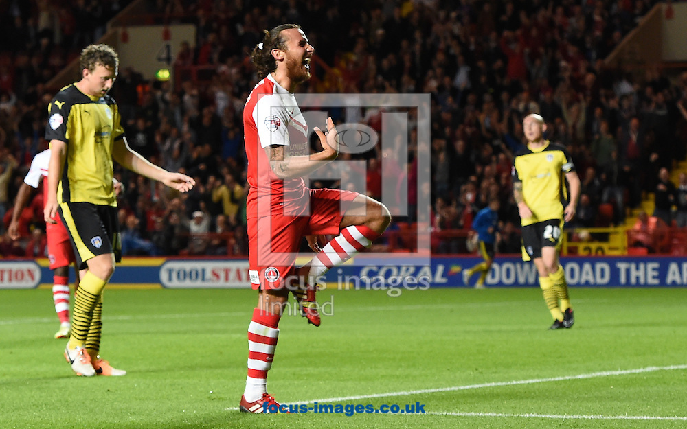 Lawrie Wilson of Charlton Athletic celebrates scoring his side's 3rd goal and his 2nd to make it 3-0 on the night during the Capital One Cup match at The Valley, London<br /> Picture by Alan Stanford/Focus Images Ltd +44 7915 056117<br /> 12/08/2014