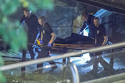 "© Licensed to London News Pictures . 06/10/2013 . Manchester , UK . The body is stretchered from the canal towards a forensic tent , for examination . Police pull a body from The Bridgewater Canal in Manchester , adjacent to the City's "" Gay Village "" . The body was spotted yesterday (6th October) afternoon and a cordon was erected as specialist police divers recovered the body .. Photo credit : Joel Goodman/LNP"